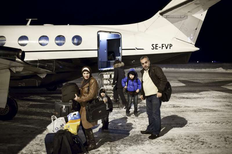 After hearing about Mahmoud's traumatic experience, the Swedish government accepted the boy and his family for resettlement. Here they are seen disembarking on a snowy January night from a passenger plane at their final destination, the small town of Torsby in south-west Sweden.
