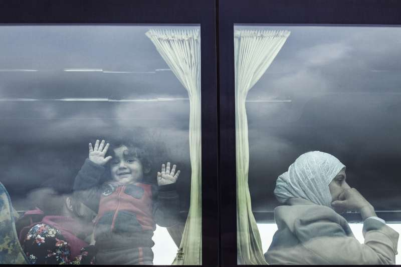 Rescued Syrian refugees are taken from the port of Augusta on Sicily, southern Italy, to a reception centre.