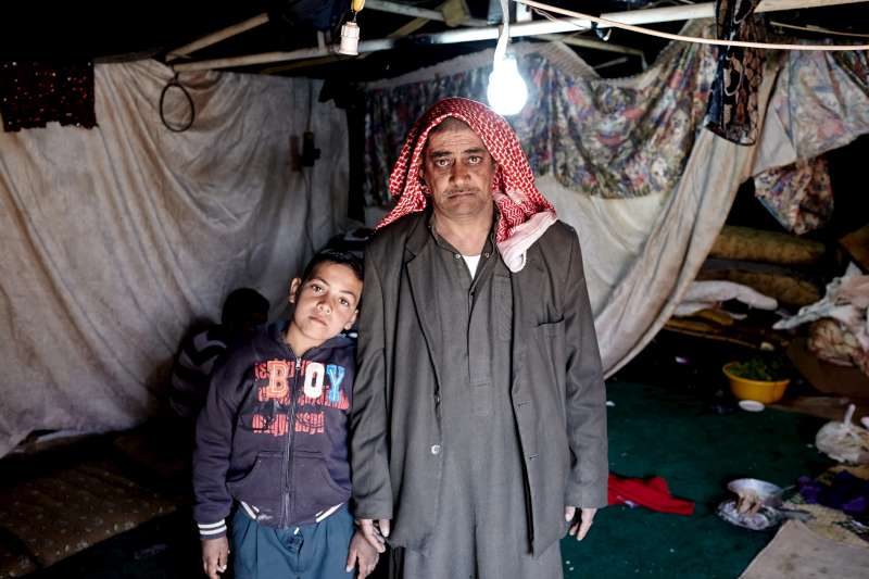 "Mohammad, with his son Khalid, aged 10, who attends the refugee school. ""If the school didn't exist, I would not send him to any school. It's dangerous outside,"" the father claimed."