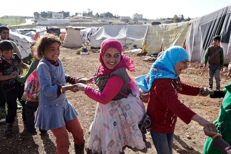 Syrian refugee girls play after classes in the Kherbet Al-Souk settlement.