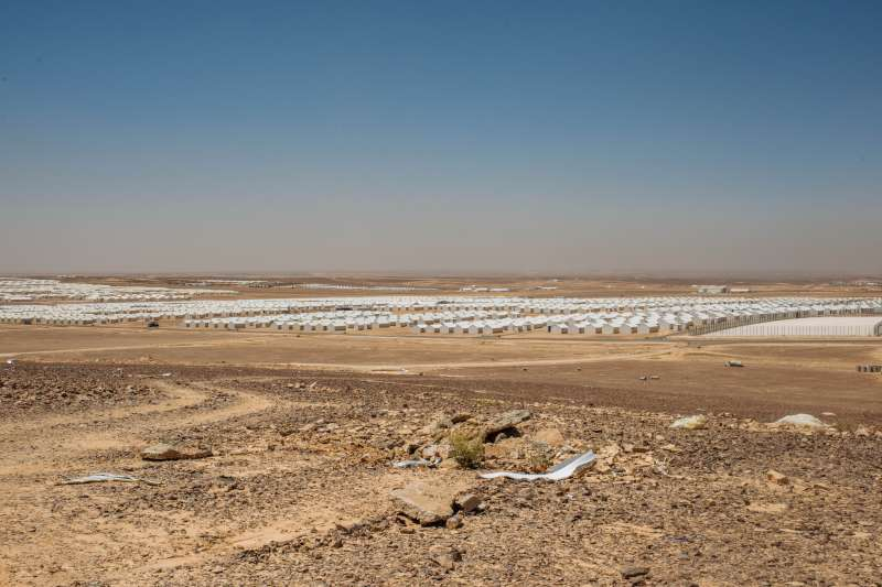 Freshly constructed but still without residents, Azraq spreads out beneath the Jordanian desert sun.