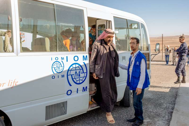 Abu Saleh gets off the bus that has brought him and his family to the new camp at Azraq. The camp was under construction for more than a year.