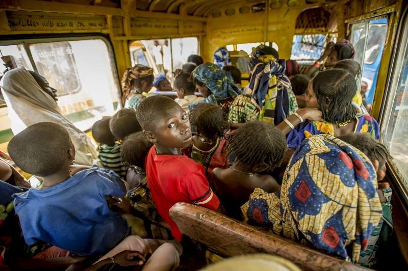 Ibrahim looks slightly apprehensive as he sits in a crowded minibus. During the long journey to safety, he never knew if he would see the rest of his family again.