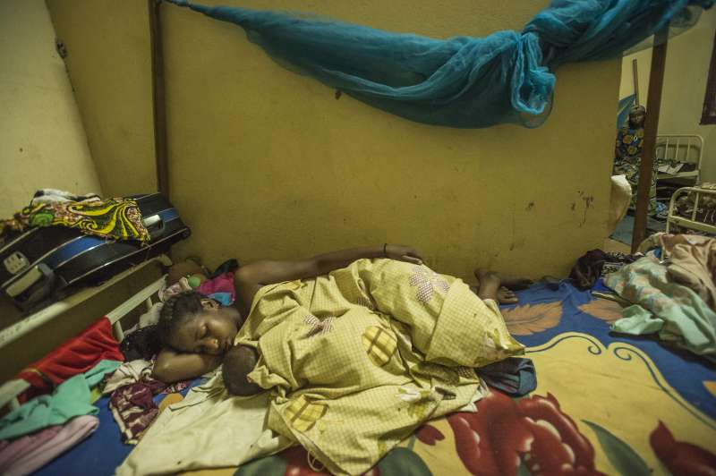 A mother and child rest at the nutrition centre.