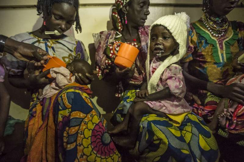 Malnourished children from Central African Republic at feeding time with their mothers in Batouri Hospital. Many children crossing the border into Cameroon are suffering from malnutrition.