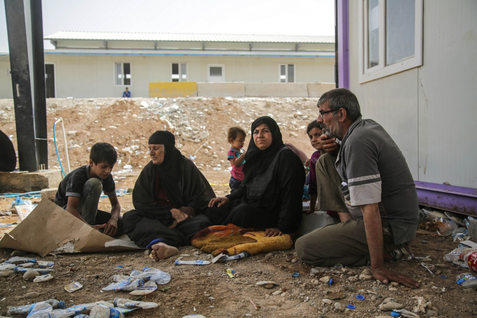 Bushra (centre right) rests with her husband and family members […]