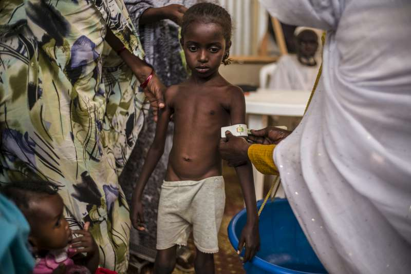 A Sudanese refugee girl is monitored for malnutrition at the […]