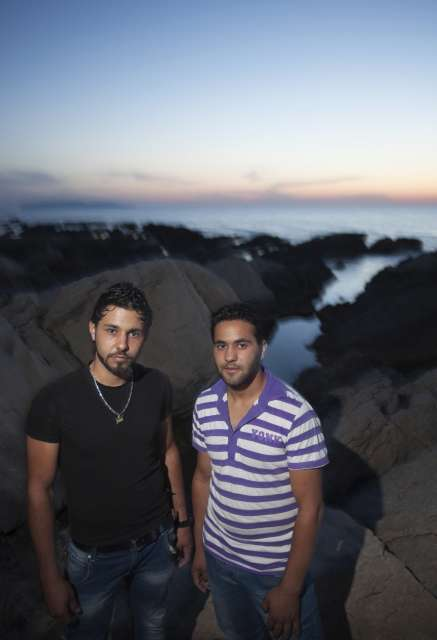 Syrian refugee brothers Thamer and Thayer stand by the shore […]