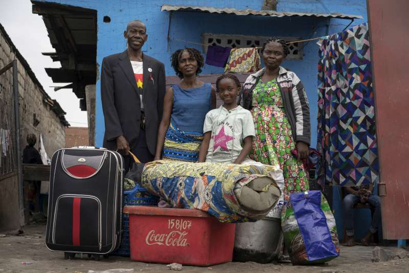 Antonio and his family with all their belongings, including packed suitcases, plastic containers and a mattress. They gave away things they did not need to friends and relatives. They were among the first group of former Angolan refugees to be repatriated.