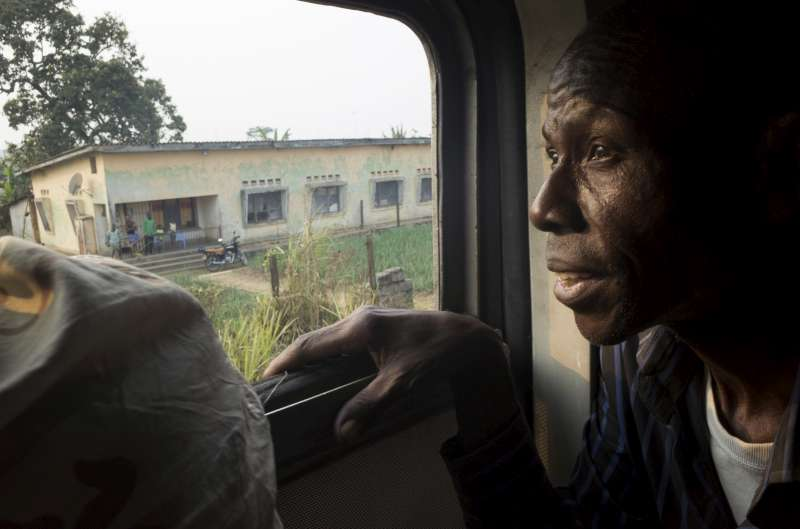 Antonio stares out of the carriage window as the train heads westwards on the 220-kilometre journey to Kimpese, where they will board buses for the journey to the border.