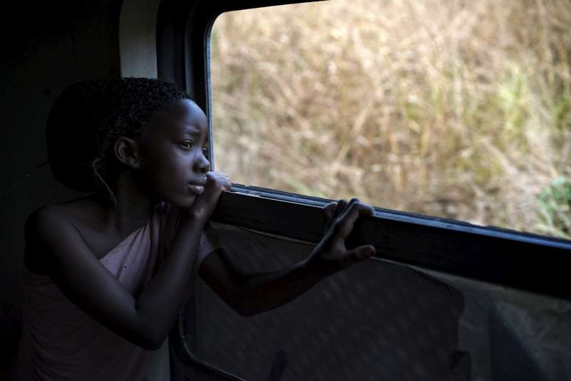 Faria takes in the sights as the train rushes towards Kimpese and she heads towards a new life in Angola, land of her forebears.