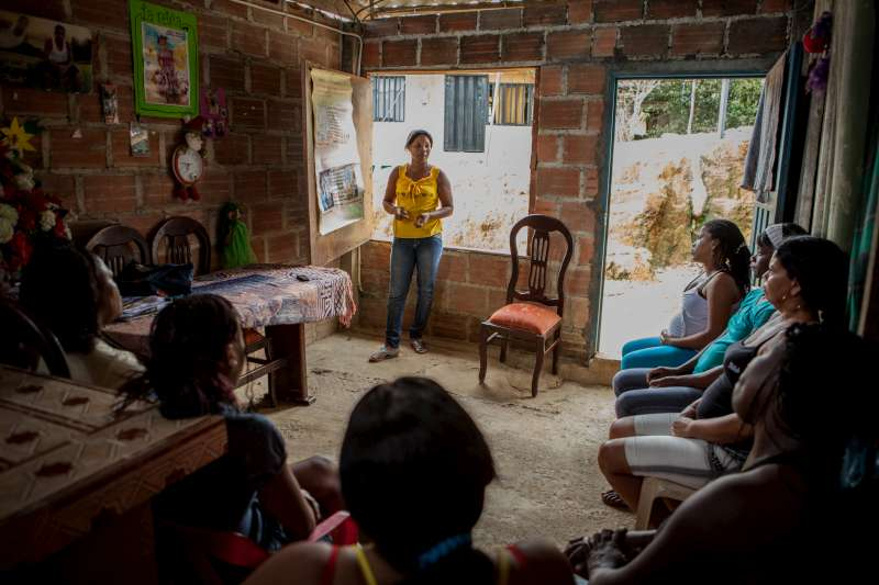 "Value Yourself: Maritza Asprilla Cruz leads a weekly workshop that teaches women about their rights. ""If you don't value yourself, no-one will value you,"" Maritza tells the participants. Butterflies believes building self-esteem will help women avoid the quagmire of violence, extortion and displacement that has become a daily reality for many in Buenaventura."