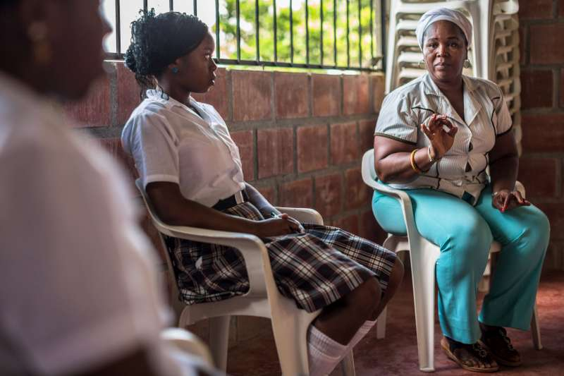 "Know your Rights: Gloria Amparo explains the Butterflies outreach programme to young women. She is convinced that the way to empower women who suffer forced displacement and abuse is to ensure they know their rights. ""When a woman knows her rights, it allows her to have choices and make decisions. Knowing your rights, you can better defend yourself and your community,"" she says."