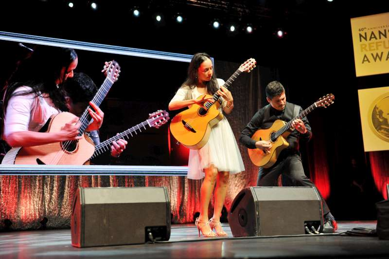 The Mexican acoustic guitar duo Rodrigo y Gabriela performs at the Nansen Refugee Award ceremony.