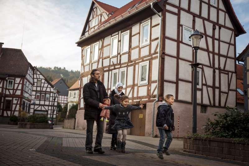 The Khawan family walks through their new hometown, Wächtersbach, Germany. From left to right, they are Ahmad, 32; his wife, Najwa, 26; daughter Ruah, 4; and son Abdullah, 6.