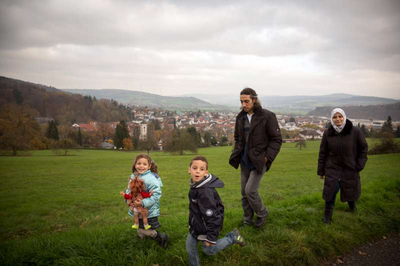 Young Abdu enjoys a walk with his family in the countryside near the German town Wächtersbach, where they were resettled. With cochlear implants and hearing aids, he can now hear almost perfectly.