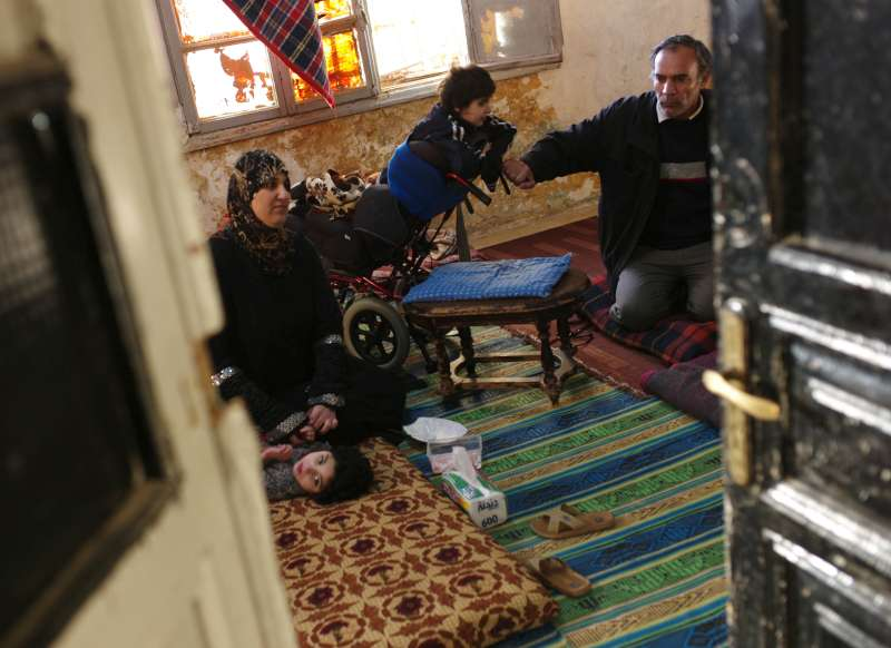 apartment inside poor. Mohammed and his family gather on the floor of their dilapidated apartment  in downtown Amman earlier today Two children are living with disability UNHCR chief urges action to tackle rising poverty Syrian