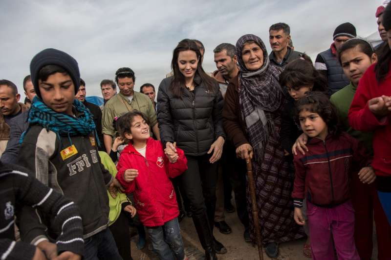 In Domiz, people shared their stories with UNHCR Special Envoy Angelina Jolie as she walked along a street running through the camp.