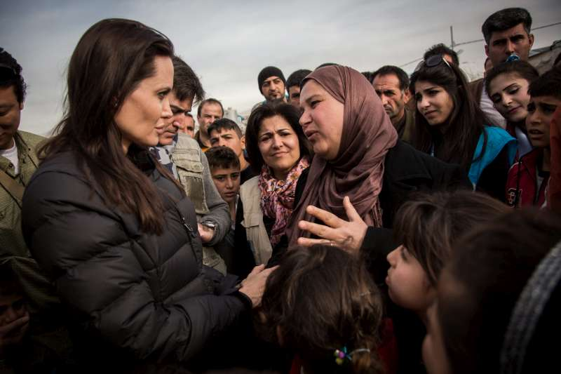 UNHCR Special Envoy Angelina Jolie hears a refugee in Domiz camp tell her harrowing tale of flight.