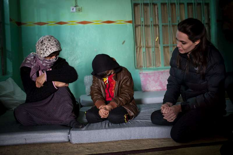 UNHCR Special Envoy Angelina Jolie meets in Bozan, northern Iraq, with a woman and her son, who were kidnapped by militants and recently released.   The mother of seven was separated from her husband and four eldest children after their capture in August 2014. Her eldest daughter was sold into slavery, and another daughter, aged nine, was taken from her by a militant. She lives with her son and youngest daughter in an abandoned building in Bozan.