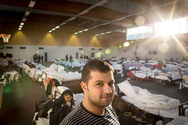 Syrian asylum-seeker, Abdel, a 28-year-old paediatrician, stands […]