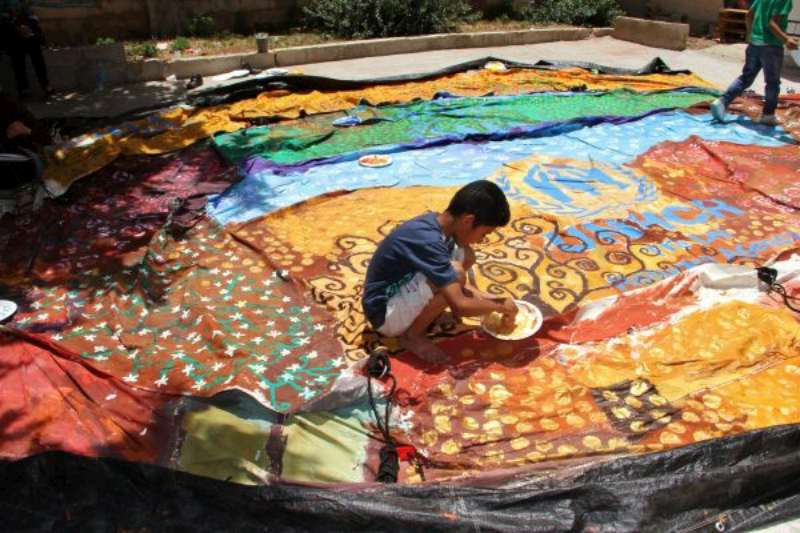 Syrian refugees transform used tents into vibrant works of art & UNHCR - Syrian refugees transform used tents into vibrant works of art