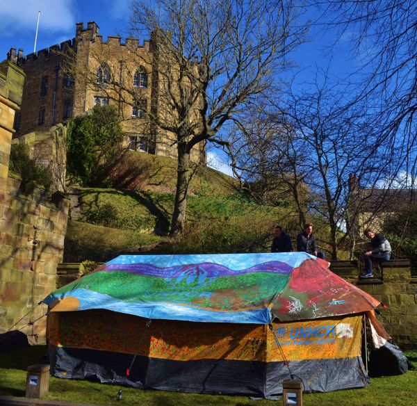 One of the tents is exhibited below historic Durham Castle. © © Courtesy of Hannah Rose Thomas & UNHCR - Syrian refugees transform used tents into vibrant works of art