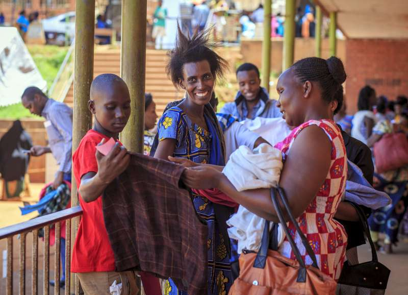 Congolese refugees compare items of clothing donated by UNIQLO, which has now distributed more than 10 million items of clothing through UNHCR.