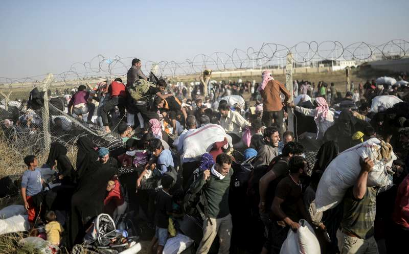 Syrians fleeing renewed fighting rush across broken down border fences earlier this week to enter southern Turkey. Turkey hosts some 1.77 million Syrian refugees – more than any other country.