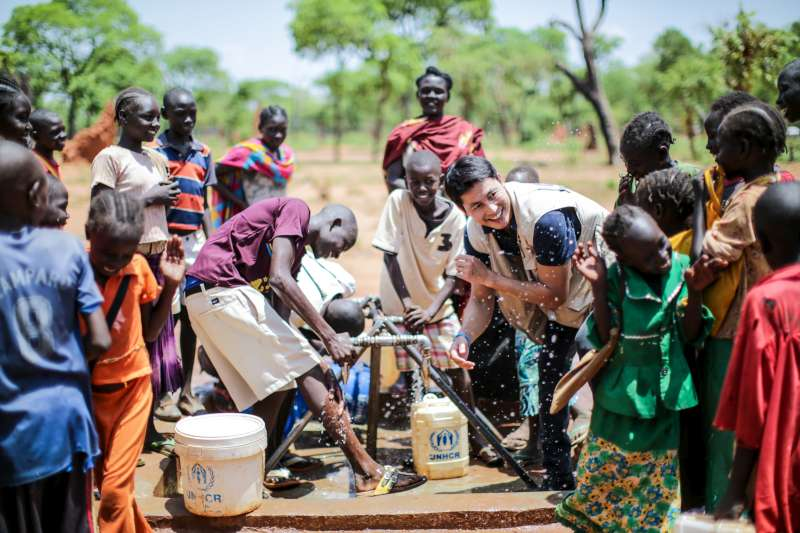 UNHCR National Goodwill Ambassador Jung Woo-sung plays with children from Sudan's South Kordofan at the Ajuong Thok refugee camp in South Sudan's Unity State during a visit in May 2015.