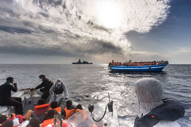 Italian Navy rescues boat filled with refugees and migrants in the Mediterranean last year. More than 2,100 people have died so far this year attempting to cross to Europe in over-crowded, flimsy vessels.