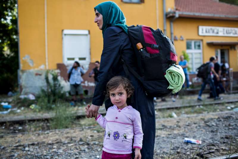 Syrian refugees wait for a train at the station in Demir Kapija, Macedonia, in June 2015.