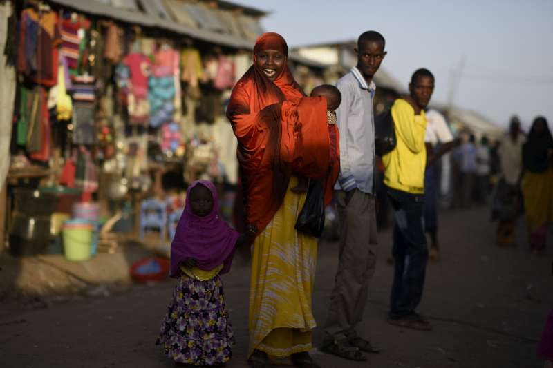 A Somali refugee woman and her children in the streets of Kakuma refugee camp.
