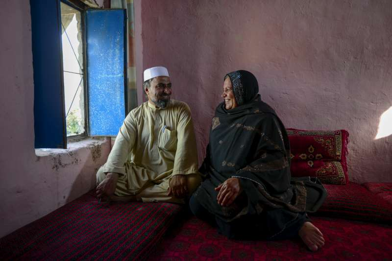 "Asifi with her husband Sher Muhammad in their home. He has championed her work with refugee girls from the beginning: ""In the future I would like [the schools] to go beyond 8th grade and include technical schools, so they can play a positive role in the development of Afghanistan,"" says Muhammad."