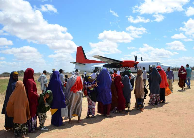 Somali refugees board a plane that will take them home to Mogadishu from Dadaab camp in Kenya.