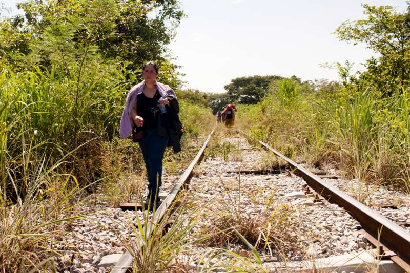 A woman from El Salvador walks along train tracks in Chiapas, Mexico, October 2015.