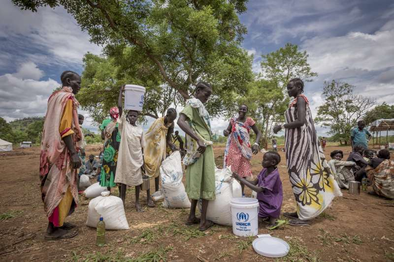 Ethiopia/ South Sudanese refugees/ food distribution. WFP is distributing food to refugees from South Sudan in Kule 1 refugee camp. After repacking the refugees bring their food items to their homes in the refugee camp in Kule 1. As the conflict in South Sudan broke out in December 2013 many South Sudanese citizens crossed the border with Ethiopia. At the end of May Ethiopia is hosting more than 130.000 refugees from South Sudan. / UNHCR/ P.Wiggers/ May 2014