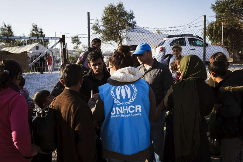 UNHCR staff welcome newly arrived Syrian refugees at the Kara Tepe site and provide information regarding the site and the registration process.
