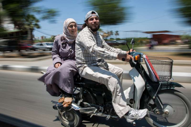 Ahmad  and his wife, Nazmiya , leave a UNHCR volunteer meeting at the UNHCR offices in Tripoli, Lebanon.