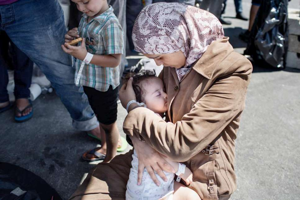 Etaidal, 22, from Damascus, cradles her daughter. Their house in Damascus was destroyed by a bomb three years ago. 