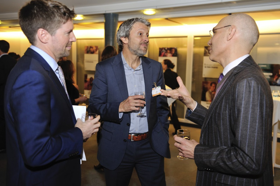 Reception in honour of members of UNHCR's inaugural Advisory Group on Gender, Forced Displacement and Protection. UNHCR Assistant High Commissioner Volker Türk, (at right), talking with advisory group member Gary Barker, from USA at center.