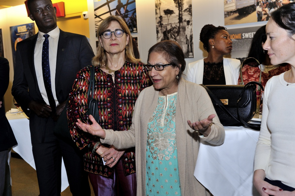 Reception in honour of members of UNHCR's inaugural Advisory Group on Gender, Forced Displacement and Protection. Advisory Group member Asma Jahangir, from Pakistan speaking , with on her left Kim Thuy Seelinger, from USA, and on her right Jacqueline Bhabha, from USA.;Victor Ochen from Uganda.