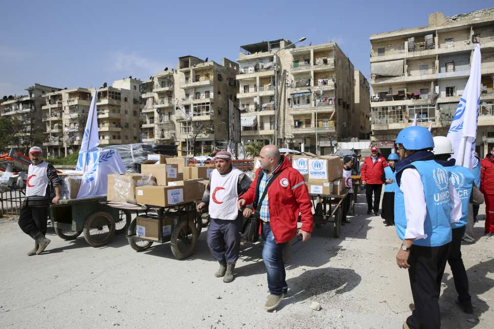 Syria/ IDPs/ UNHCR staff and Syrian Arab Red Crescent (SARC) aid workers are preparing to cross into the eastern neighborhoods of Aleppo carrying the precious aid. A six-hour truce between the Syrian government and anti-government forces enabled UNHCR Syria and SARC to deliver medicine, medical supplies and winter clothing as we'll as food supplies from the World Food Programme to more than 7,000 people in the hard-to-access Bustan Al-Qasr, Al-Ansari, Al-Firdos, Al-Sukari and Mwasalat neighborhoods of Syria's second largest city Aleppo. This cross line mission was carried out for the first time since last October. 45 carts were used to transport the aid from UNHCR trucks at the Bustan Al Qasr crossing point and then pulled across the frontline. It took several trips to complete the operation. Eastern Aleppo has suffered particularly badly since the Syria crisis began in March 2011, but despite the fighting it is still home to an estimated 600,000 people./ UNHCR/B.Diab/ March 2015