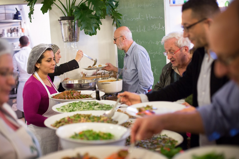 Refugee chefs Nahrein Abdal and Mariam Al Bakkour serve lunch to diners at Tawlet, a restaurant in Beirut.