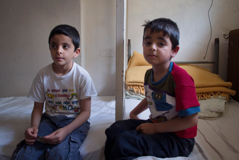 Mohammad and Ahmed in the dilapidated room they share with their blind mother, Jihan, in Greece's Lavrion camp. They have assumed new responsibilities in their father's absence.