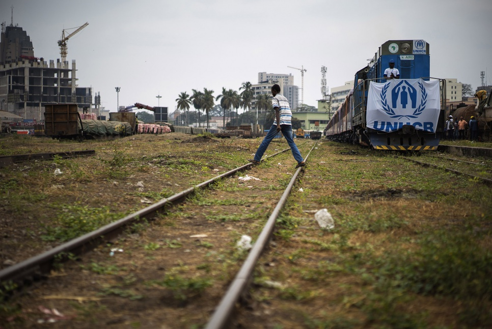 A train carrying hundreds of former refugees prepares to pull out of Kinshasa Est station in DRC. The passengers are embarking on a long journey home to Angola.