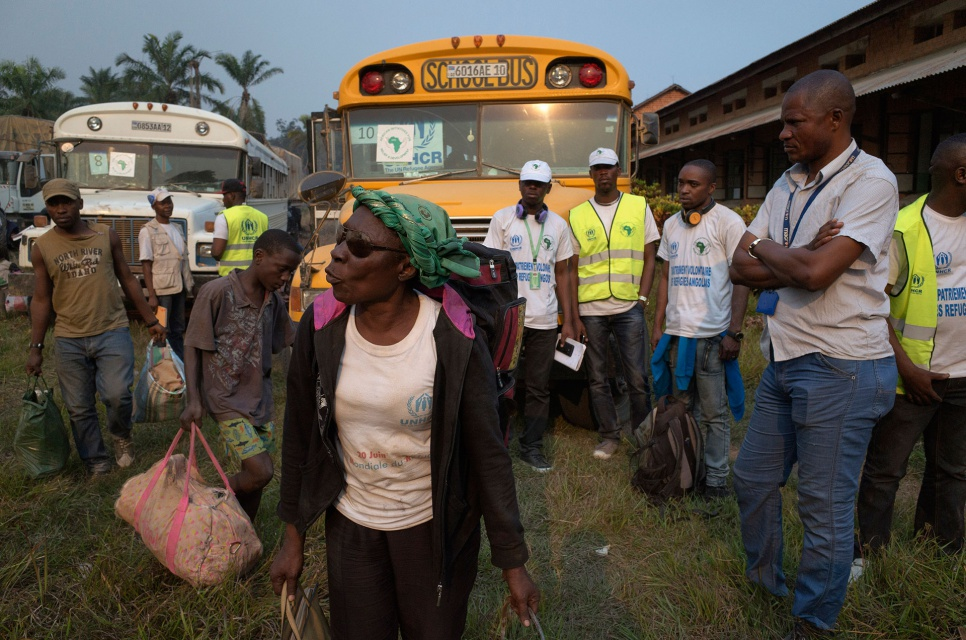 Clara, 60, arrives in the Congolese town of Kimpangu, where Angolan authorities will check her papers before letting her cross the border and return home after decades in exile.