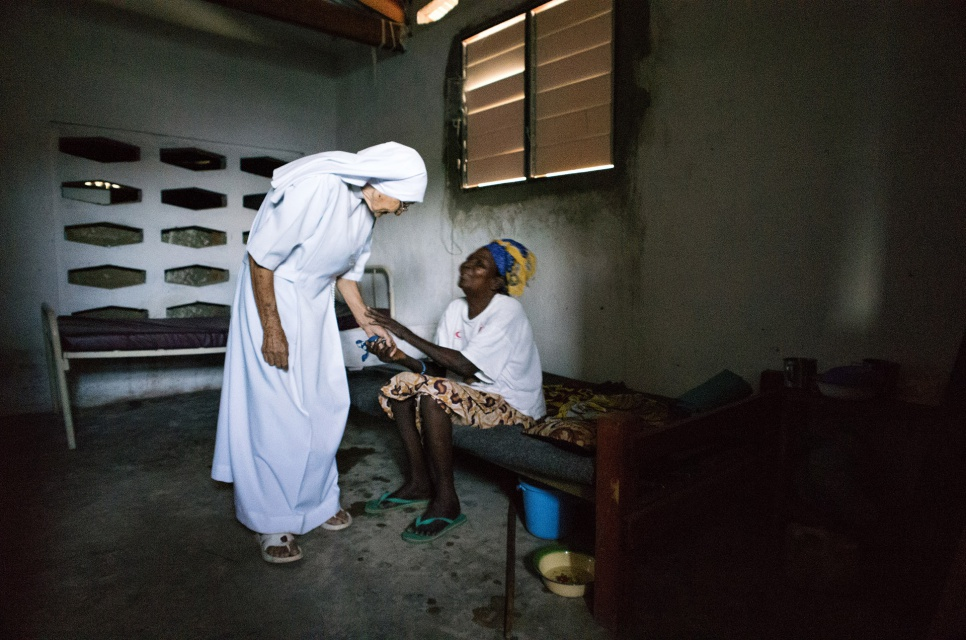 Sister Maria speaks with a patient at the hospital where she works as a midwife in Zongo, Equateur Province, DRC. The sister first arrived in Congo in 1959.