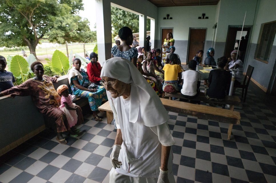 Always busy, 80-year-old Sister Maria Concetta walks through the reception area of the hospital her order operates in Zongo, Equateur Province, DRC.