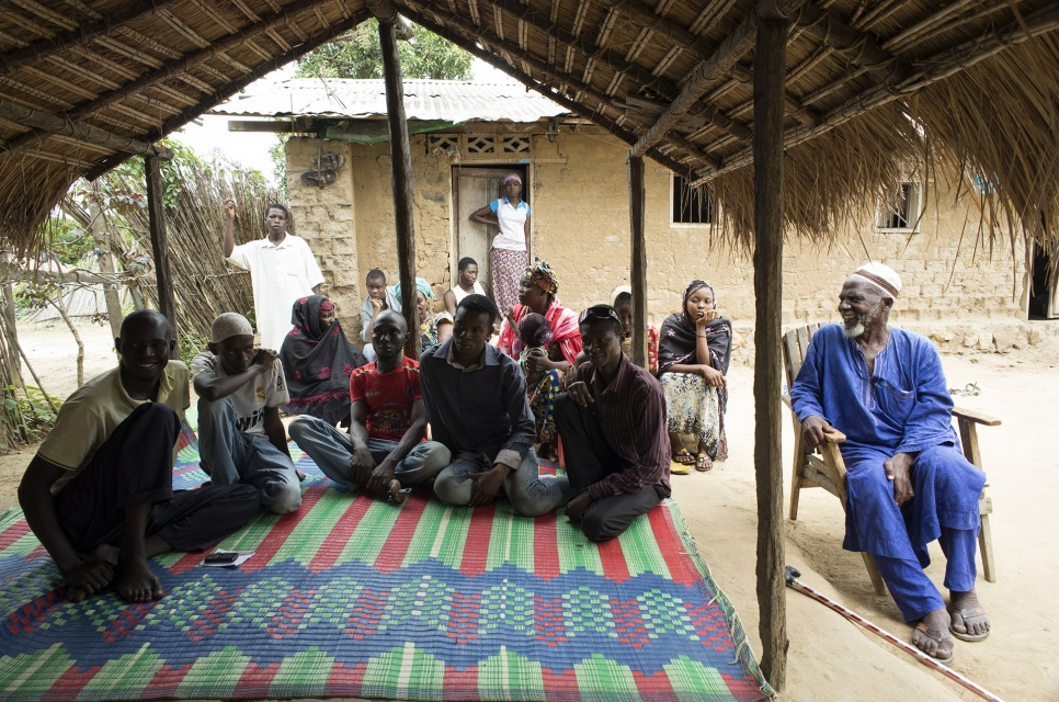 Imam Moussa Bawa, 72, hosts a discussion on reconciliation with Muslim refugees from CAR at his home in Zongo, DRC.